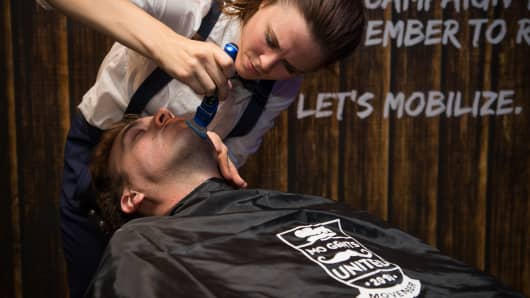 A man receives a clean shave ahead of Movember